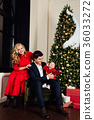 Portrait of a family on a christmas tree 36033272