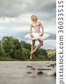 Ballerina jumping above river 36033515
