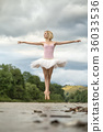 Ballerina jumping above river 36033536