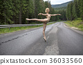 Ballerina posing outdoors 36033560