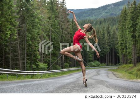 Ballerina posing outdoors 36033574