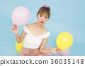 A woman with a balloon 36035148