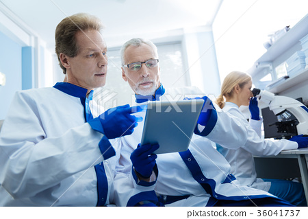 Determined biologists discussing gene results 36041737