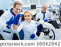 Happy scientists working with test tubes 36042042