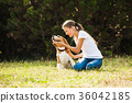 Girl plays with a dog 36042185