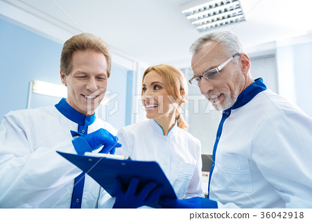 Cheerful scientists happy with the test results 36042918