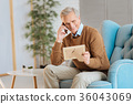 Extremely happy elderly man talking with family on 36043069