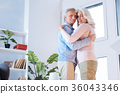 Emotional senior husband and wife enjoying 36043346