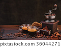 Coffee beans and grinder. 36044271
