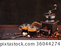 Coffee beans and grinder. 36044274