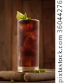 Glass of cola with ice. 36044276