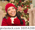 Warmly Dressed Girl In Front of Christmas Tree 36054288