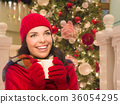 Warmly Dressed Girl In Front of Christmas Tree 36054295