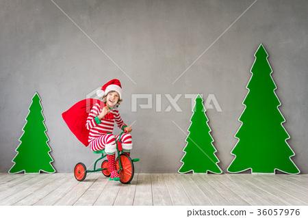 Happy child on Christmas eve 36057976