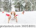 Happy child outdoor in winter 36058001