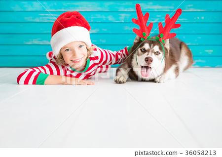 Happy child and dog on Christmas eve 36058213