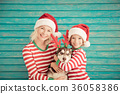 Happy child and dog on Christmas eve 36058386