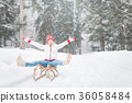 Happy woman outdoor in winter 36058484