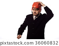 Furious businessman wearing hockey helmet 36060832