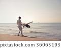 Young couple having fun on a sandy coast 36065193