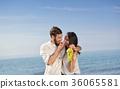 Young happy couple having date on seashore 36065581