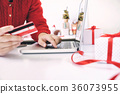 Woman holding credit card and shopping online. 36073955