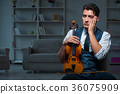Young musician man practicing playing violin at 36075909