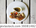 Sea bass fillet on wood background 36081482