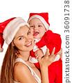 Christmas family under holiday tree. 36091738