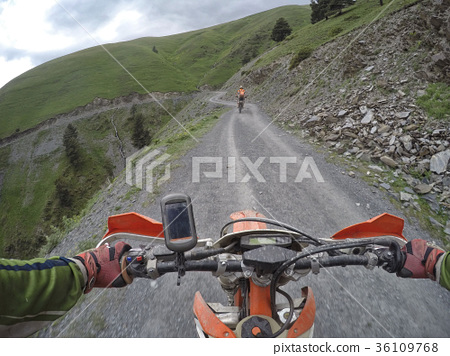 Enduro journey with dirt bike high in the 36109768