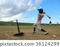 Baseball boy practicing batting under blue sky 36124299