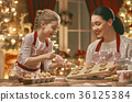 cooking Christmas cookies 36125384