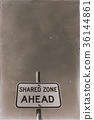 in the empty sky the sign of shared zone ahead 36144861