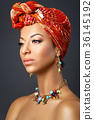 beautiful mulatto young woman with turban on head 36145192