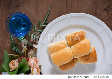 Tasty sausage rolls bread with flower Flat lay 36158040