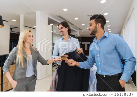 Business Man Giving Female Seller Credit card 36159337