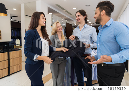 Two Female Shop Assistants Offering Young 36159339