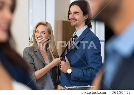 Happy Smiling Business Man Try New Suit With Young 36159415