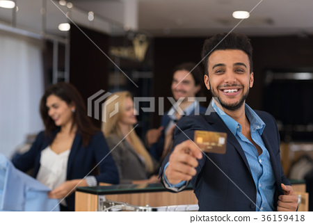 Latin Man In Suit Hold Credit Card Happy Smiling 36159418