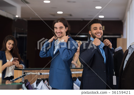 Two Handsome Business Men Wearing New Suits While 36159421