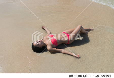 Attractive Young Caucasian Woman In Swimsuit Lying 36159494