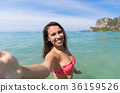 Attractive Young Caucasian Woman In Swimsuit On 36159526