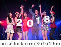 Teenagers are celebrating at the night party. 36164966