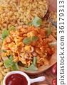 Fried macaroni with sausage and tomato sauce. 36179313