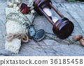 Antique pocket watch and hourglass with flowers. 36185458