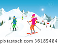 Couple skiing in the mountains against blue sky. 36185484