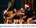 Happy girls celebrating Christmas party 36195284