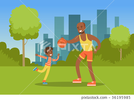 Father playing ball with his son in city park 36195985