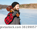 Man with ukelele on a frozen lake 36199057
