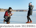 Man playing ukelele for his girlfriend 36199061